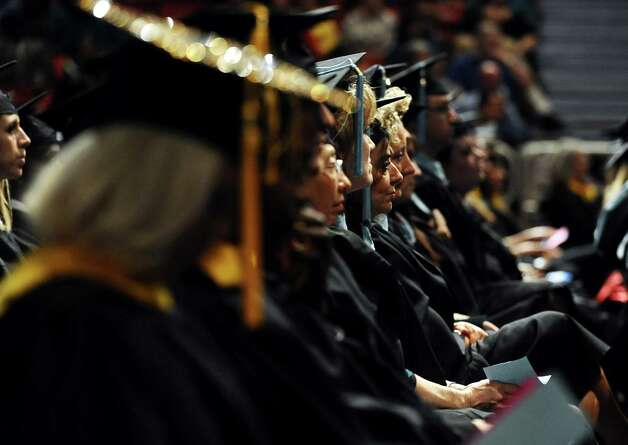 Lamar University conferred nearly 1,200 degrees on Saturday, December 15, 2012, during the fall commencement in the Montagne Center.   Photo taken: Randy Edwards/The Enterprise Photo: Randy Edwards