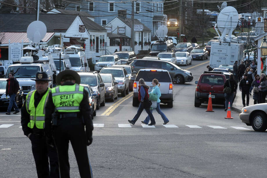 Car and pedestrian traffic clogs the Sandy Hook neighborhood of Newtown, Conn., Dec. 15th, 2012, the day after the mass shooting at Sandy Hook Elementary school on Friday. Photo: Ned Gerard / Connecticut Post