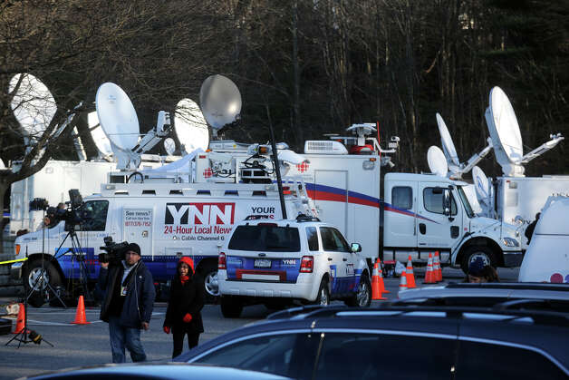 Satellite trucks in Treadwell Park, in Newtown, Conn., Dec. 15th, 2012. The town park has become a small village for press and media that have descended on the town following the mass shooting at Sandy Hook Elementary School on Friday. Photo: Ned Gerard / Connecticut Post