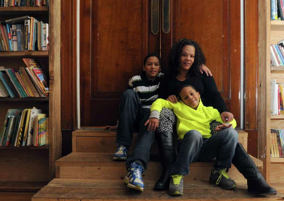 Lateepha Hoating with her two sons six-year-old Jayshaun Dale and eleven-year-old Kay'shawn Cruz in Schenectady, NY Friday Dec. 14, 2012. (Michael P. Farrell/Times Union) Photo: Michael P. Farrell