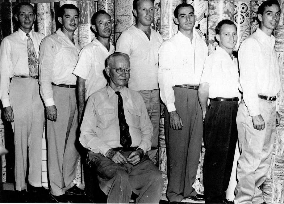 The Flores brothers: John (left to right), Benedict, William, Ernest, Leo, Thomas and Francis all served overseas during World War II. Seated is their father, John N. Flores Sr. Photo: Lana Summers / Courtesy Photo / San Antonio Express-News