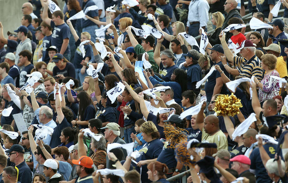 O'Connor supporters wave towels before the start of the game against Houston Lamar in the Class 5A Div. I state semifinal football game in Austin on Saturday, Dec. 15, 2012. O'Connor lost to Lamar, 15-7. Photo: Kin Man Hui, Express-News / © 2012 San Antonio Express-News