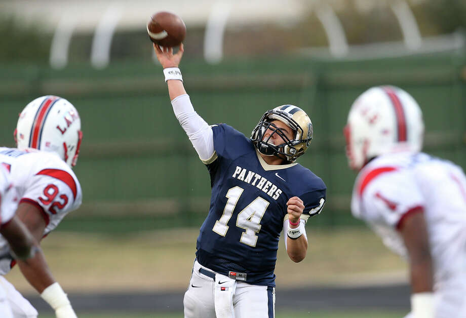 O'Connor quarterback Zach Galindo (14) attempts a pass against Houston Lamar in the Class 5A Div. I state semifinal football game in Austin on Saturday, Dec. 15, 2012. O'Connor lost to Lamar, 15-7. Photo: Kin Man Hui, Express-News / © 2012 San Antonio Express-News