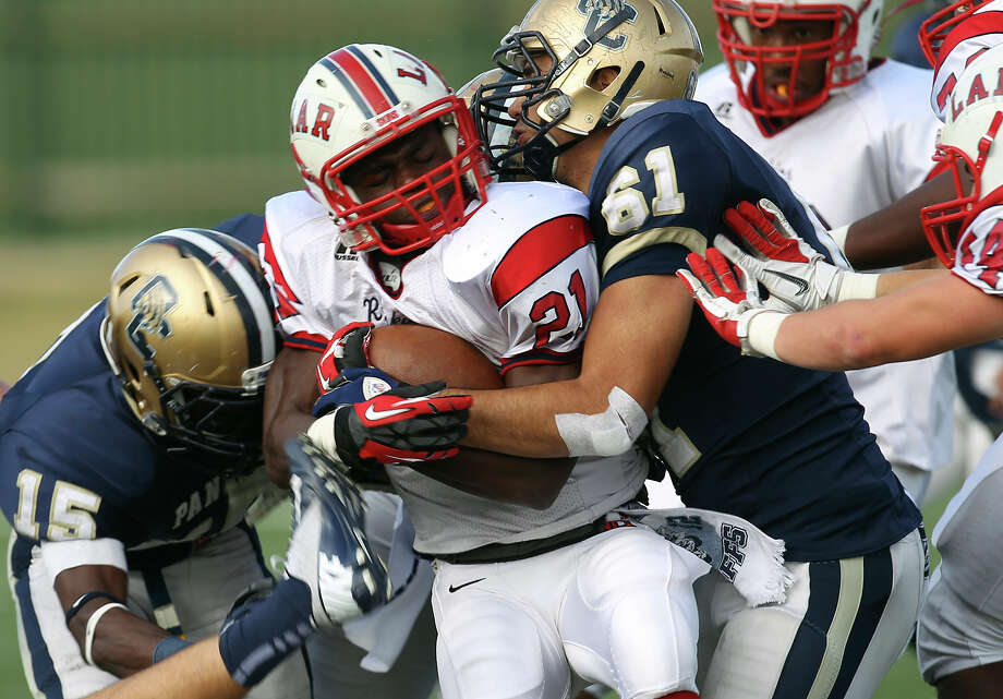 O'Connor's Leonardo Soriano (61) and Alan Wright (15) tackle Houston Lamar's Ronnie Wesley (21) in the first half in the Class 5A Div. I state semifinal football game in Austin on Saturday, Dec. 15, 2012. O'Connor lost to Lamar, 15-7. Photo: Kin Man Hui, Express-News / © 2012 San Antonio Express-News
