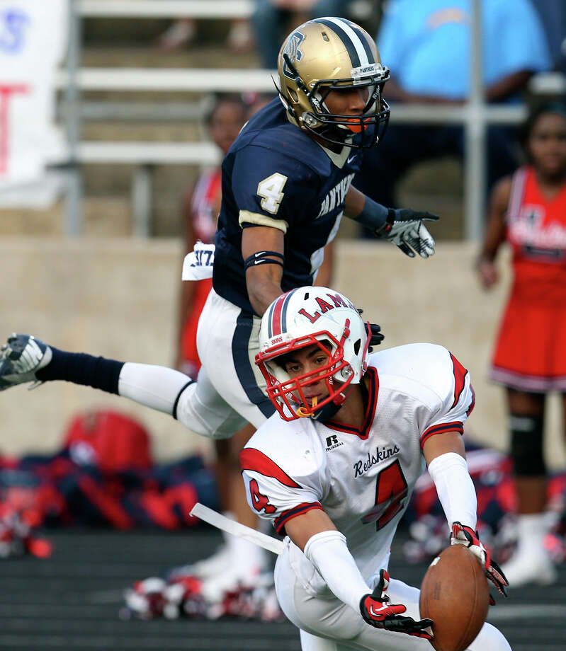 Houston Lamar's John Bonney (04) nearly picks off a pass for O'Connor's Nate Phillips (top) in the second half in the Class 5A Div. I state semifinal football game in Austin on Saturday, Dec. 15, 2012. O'Connor lost to Lamar, 15-7. Photo: Kin Man Hui, Express-News / © 2012 San Antonio Express-News