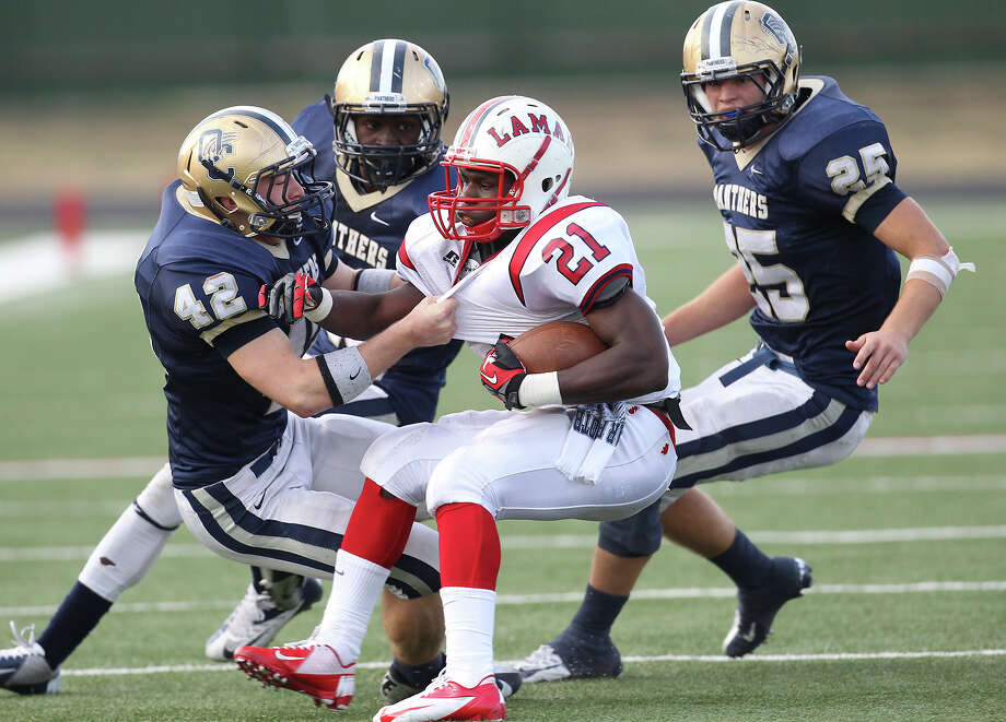 O'Connor's Kody Fields (42), Alan Wright (15) and Luke Farmer (25) gang up to tackle Houston Lamar's Ronnie Wesley (21) in the second half in the Class 5A Div. I state semifinal football game in Austin on Saturday, Dec. 15, 2012. O'Connor lost to Lamar, 15-7. Photo: Kin Man Hui, Express-News / © 2012 San Antonio Express-News