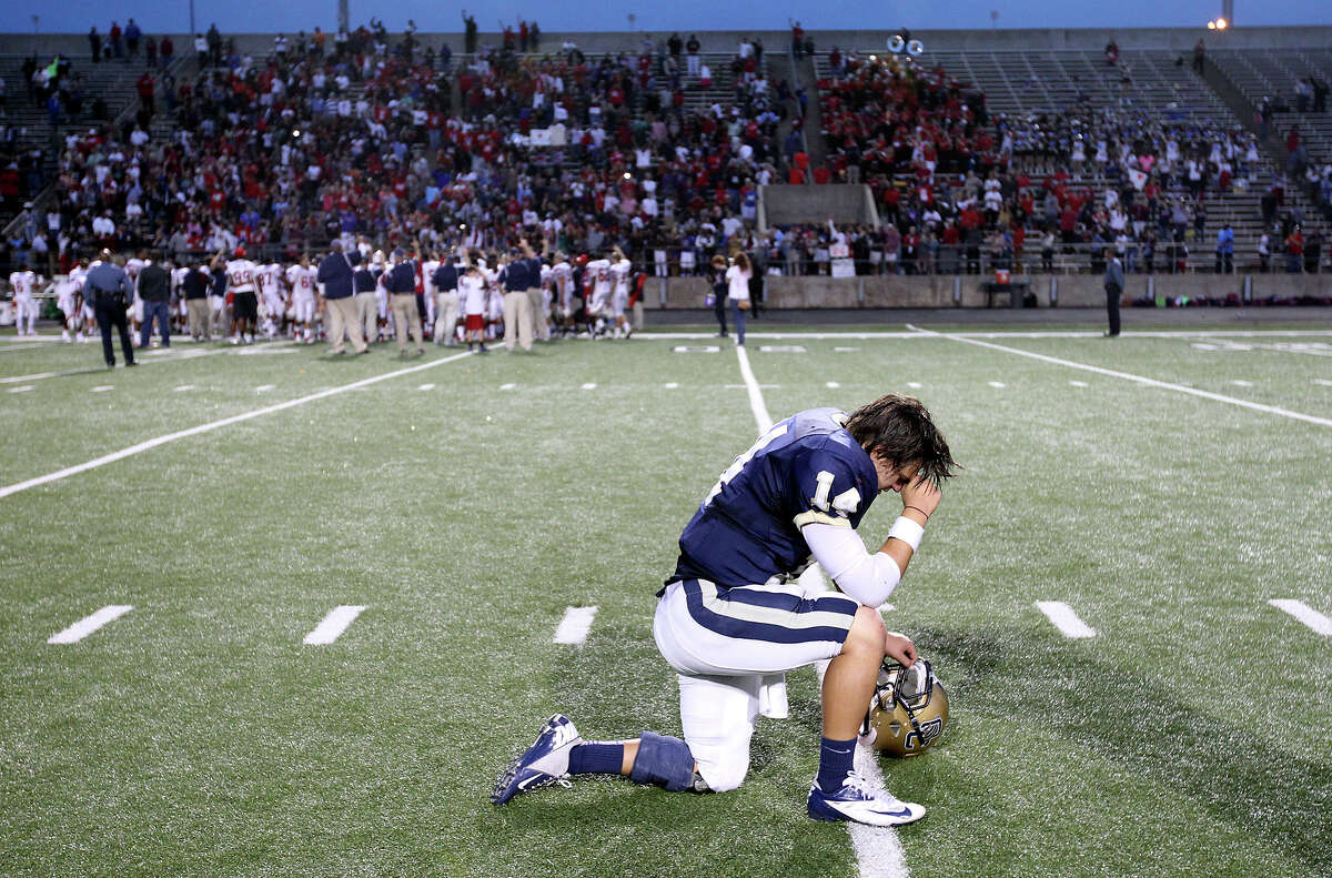 O'Connor quarterback Zach Galindo takes a moment to himself after the Panthers' loss to Houston Lamar in the Class 5A Div. I state semifinal football game in Austin on Saturday, Dec. 15, 2012. O'Connor lost to Lamar, 15-7.