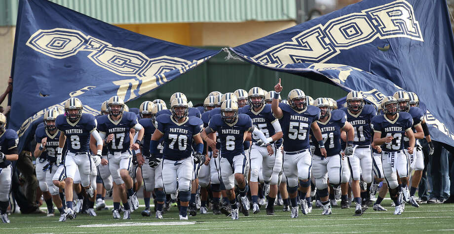 The O'Connor football team takes the field for their game against Houston Lamar in the Class 5A Div. I state semifinal football game in Austin on Saturday, Dec. 15, 2012. O'Connor lost to Lamar, 15-7. Photo: Kin Man Hui, Express-News / © 2012 San Antonio Express-News