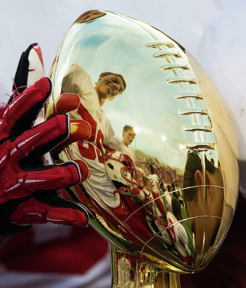 Katy outside linebacker Carson Strickler (25) is reflected in the Class 5A Division II state semifinal champions trophy after the victory. Photo: Smiley N. Pool, Houston Chronicle / © 2012  Houston Chronicle