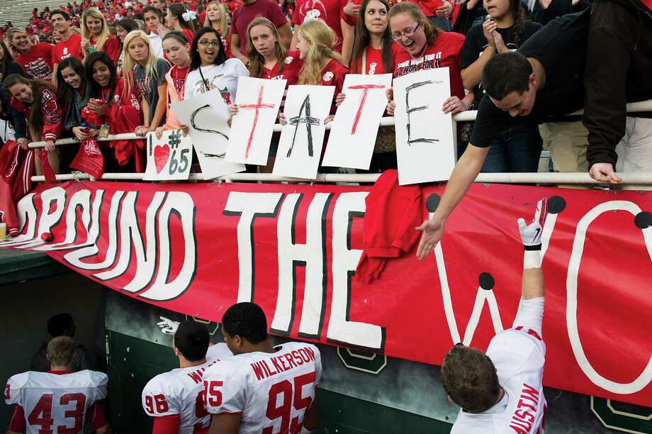 Katy fans hold up signs spelling out their team's next destination - the state championship game next week in Arlington - following a victory over Cibolo Steele. Photo: Smiley N. Pool, Houston Chronicle / © 2012  Houston Chronicle