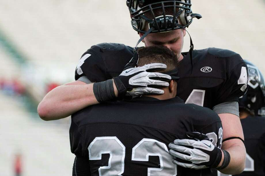 Cibolo Steele defensive end Josh Malin (44) hugs linebacker Jalen Maddox (33) following the loss to Katy. Photo: Smiley N. Pool, Houston Chronicle / © 2012  Houston Chronicle