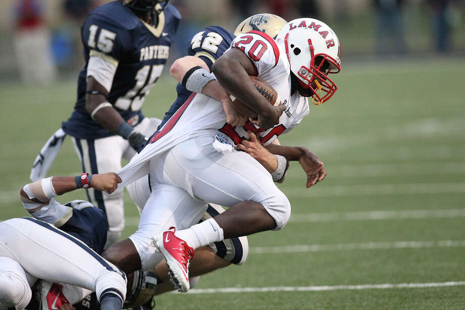 Houston Lamar's Levy Whiteing (20) pushes forward despite the defense of O'Connor's Kody Fields (42) and Marces Garza-Dishmon (30) in the second half. Photo: Kin Man Hui, San Antonio Express-News / © 2012 San Antonio Express-News