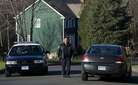 Police block a road near the house of Nancy Lanza, mother of Adam Lanza, on December 15, 2012 in Sandy Hook, Connecticut. Lanza, 20, was identified by authorities as the black-clad killer who fatally shot his mother in her home, gunned down 26 children and adults at Sandy Hook Elementary School, and then committed suicide on December 14.     AFP PHOTO/DON EMMERTDON EMMERT/AFP/Getty Images Photo: Don Emmert, AFP/Getty Images