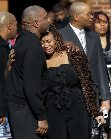 Mourners hug outside Hopewell Missionary Baptist Church at the end of a funeral for Jerry Brown, a linebacker on the Dallas Cowboys practice squad, Saturday, Dec. 15, 2012, in St. Louis. Brown was killed in a car accident on Dec. 8, that left his teammate and friend, Cowboys defensive tackle Josh Brent, facing a manslaughter charge for allegedly driving drunk. (AP Photo/Jeff Roberson) Photo: Jeff Roberson, Associated Press / AP