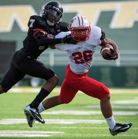 Katy running back Rodney Anderson (26) is tackled by Cibolo Steele defensive back Carl Cunningham (7) during the first quarter in a Class 5A Division II state high school football semifinal game at Floyd Casey Stadium on Saturday, Dec. 15, 2012, in Waco. ( Smiley N. Pool / Houston Chronicle ) Photo: Smiley N. Pool, Express-News / © 2012  Houston Chronicle