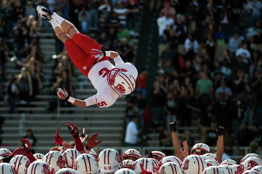 Katy wide receiver Luke Nelson (5) flies over his teammates as they take the field to face Cibolo Steele in a Class 5A Division II state high school football semifinal game at Floyd Casey Stadium on Saturday, Dec. 15, 2012, in Waco. ( Smiley N. Pool / Houston Chronicle ) Photo: Smiley N. Pool, Express-News / © 2012  Houston Chronicle