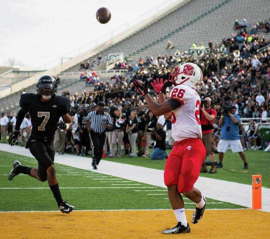 Katy running back Rodney Anderson (26) catches a 25-yard touchdown pass as Cibolo Steele defensive back Carl Cunningham (7) defends during the first quarter in a Class 5A Division II state high school football semifinal game at Floyd Casey Stadium on Saturday, Dec. 15, 2012, in Waco. ( Smiley N. Pool / Houston Chronicle ) Photo: Smiley N. Pool, Express-News / © 2012  Houston Chronicle