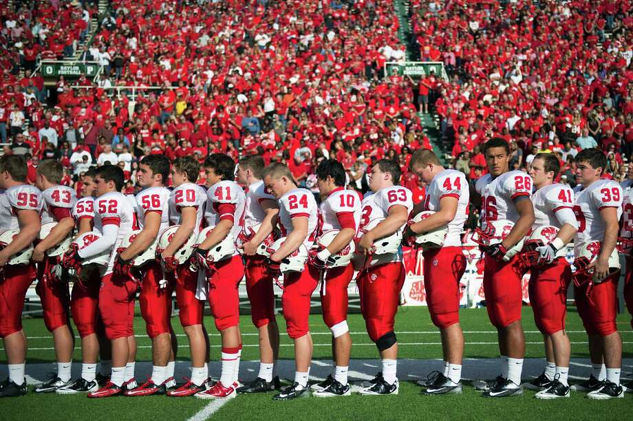 Katy players observe a moment of silence for the victims of the of Connecticut school shooting before facing against the in a Class 5A Division II state high school football semifinal game at Floyd Casey Stadium on Saturday, Dec. 15, 2012, in Waco. ( Smiley N. Pool / Houston Chronicle ) Photo: Smiley N. Pool, Express-News / © 2012  Houston Chronicle