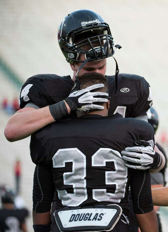 Cibolo Steele defensive end Josh Malin (44) hugs linebacker Jalen Maddox (33) following a loss to Katy in a Class 5A Division II state high school football semifinal game at Floyd Casey Stadium on Saturday, Dec. 15, 2012, in Waco.  Katy won the game 45-33. (Smiley N. Pool / Houston Chronicle ) Photo: Smiley N. Pool, Express-News / © 2012  Houston Chronicle