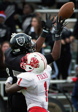 Cibolo Steele wide receiver Thaddeous Thompson (17) catches a deep pass to set up a third quarter touchdown as Katy defensive back Kyle Fulks (1) defends in a Class 5A Division II state high school football semifinal game at Floyd Casey Stadium on Saturday, Dec. 15, 2012, in Waco.  Katy won the game 45-33. (Smiley N. Pool / Houston Chronicle ) Photo: Smiley N. Pool, Express-News / © 2012  Houston Chronicle