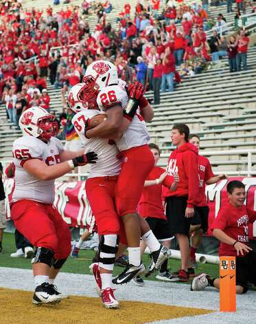Katy running back Rodney Anderson (26) celebrates with tight end Logan Lister (87) and offensive linesman Kyle Miller (65) after scoring on a 3-yard touchdown run during the fourth quarter against the Cibolo Steele in a Class 5A Division II state high school football semifinal game at Floyd Casey Stadium on Saturday, Dec. 15, 2012, in Waco.  Katy won the game 45-33. (Smiley N. Pool / Houston Chronicle ) Photo: Smiley N. Pool, Express-News / © 2012  Houston Chronicle