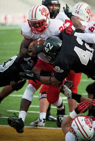 iKaty running back Adam Taylor (28) gets past Cibolo Steele defensive end Jaelen Lewis (42) for a touchdown during the third quarter in a Class 5A Division II state high school football semifinal game at Floyd Casey Stadium on Saturday, Dec. 15, 2012, in Waco.  Katy won the game 45-33. (Smiley N. Pool / Houston Chronicle ) Photo: Smiley N. Pool, Express-News / © 2012  Houston Chronicle