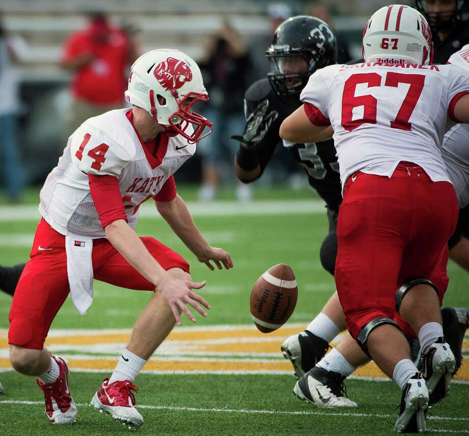 Katy quarterback Josh Williams (14) fumbles a snap, turning the ball over to Cibolo Steele during the third quarter in a Class 5A Division II state high school football semifinal game at Floyd Casey Stadium on Saturday, Dec. 15, 2012, in Waco.  Katy won the game 45-33. (Smiley N. Pool / Houston Chronicle ) Photo: Smiley N. Pool, Express-News / © 2012  Houston Chronicle