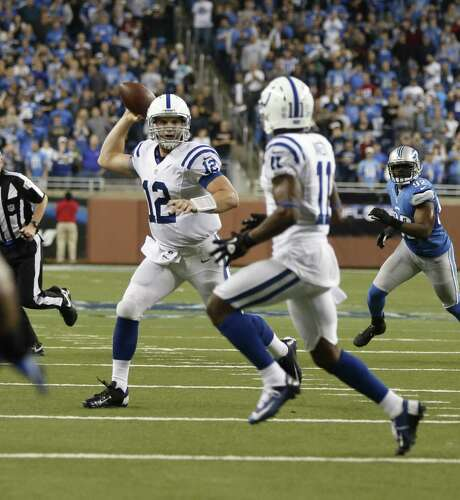 The Colts' Andrew Luck, left, has a winning touch this year, setting a rookie record for most wins by a No. 1 QB pick. Photo: JULIAN H. GONZALEZ, MBR / Detroit Free Press