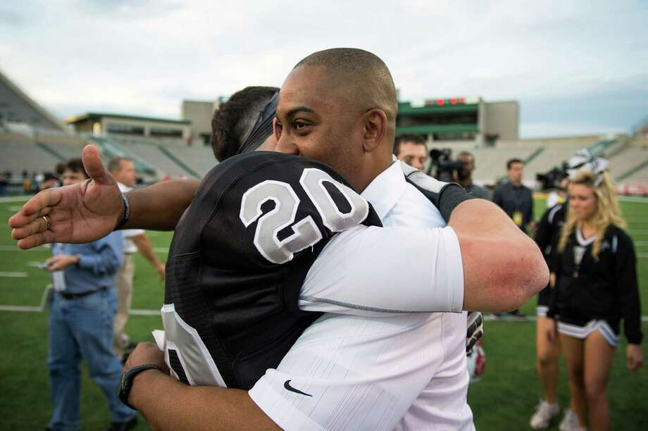 Cibolo Steele head coach Michael Jinks hugs wide receiver Matthew Mayle (20) following a loss to Katy in a Class 5A Division II state high school football semifinal game at Floyd Casey Stadium on Saturday, Dec. 15, 2012, in Waco.  Katy won the game 45-33. (Smiley N. Pool / Houston Chronicle ) Photo: Smiley N. Pool, Express-News / © 2012  Houston Chronicle