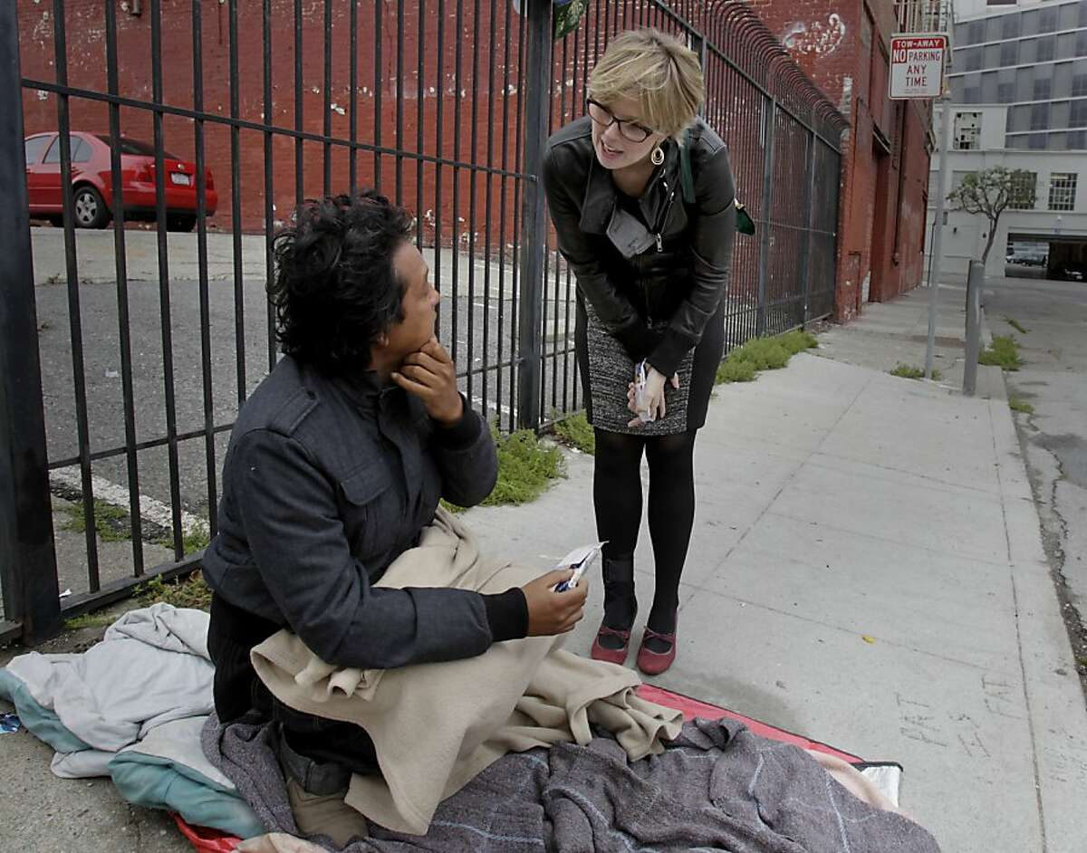 Kara Zordel stops to talk with a homeless man in an alley near Market Street. Kara Zordel is the director of San Francisco's Project Homeless Connect and a new daily version. Her sensitivity to the subject of homelessness comes partly from her own experiences living in poverty as a child.