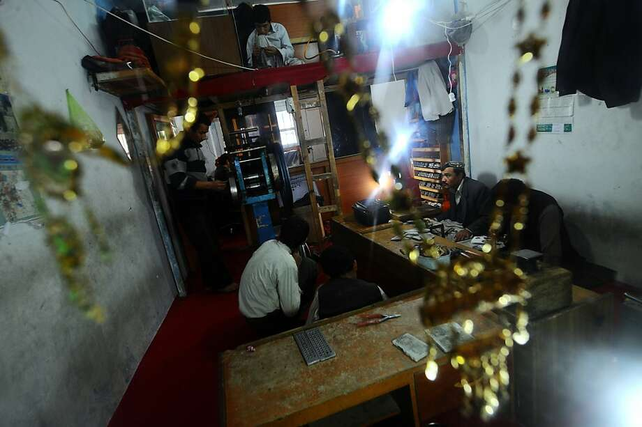 Jewelers work diligently on gold in a jewelry shop in Mazar-i Sharif, Afghanistan. Photo: Qais Usyan, AFP/Getty Images
