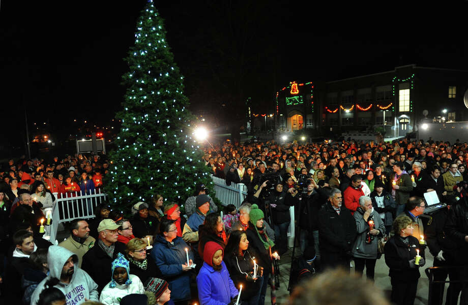 Hundreds attend a candlelight vigil in memory of victims from yesterday's mass shooting, which was held behind Stratford High School on the Town Hall Green in Stratford, Conn. on Saturday December 15, 2012. Photo: Christian Abraham / Connecticut Post