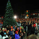Hundreds attend a candlelight vigil in memory of victims from yesterday's mass shooting, which was held behind Stratford High School on the Town Hall Green in Stratford, Conn. on Saturday December 15, 2012.