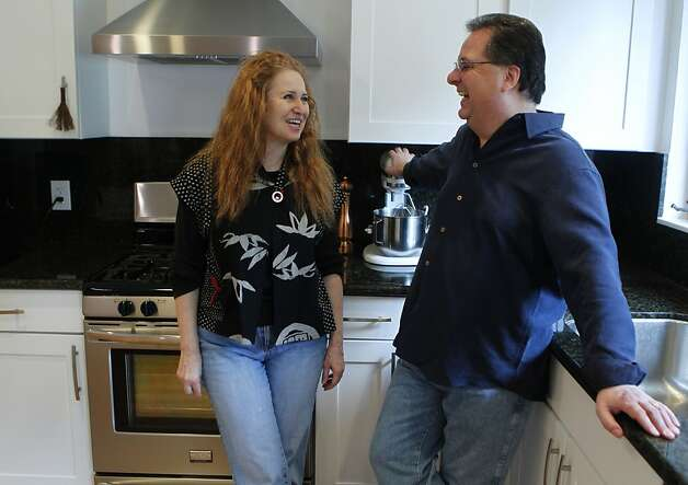 Holly and Jim Young bought their home in Oakland six months ago. They say the mortgage-interest deduction was a big factor in their decision to buy. Photo: Paul Chinn, The Chronicle