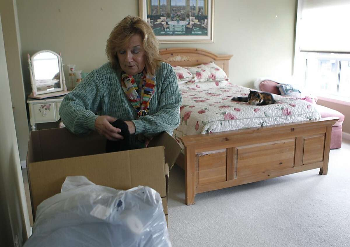 Shirley Ann Stern packs boxes before moving from her condo in San Francisco, Calif. on Friday, Dec. 14, 2012. Stern just purchased a new home near the UCSF Mission Bay campus. Congress may curtail the mortgage-interest tax deduction which, she says, would make life a lot harder financially.