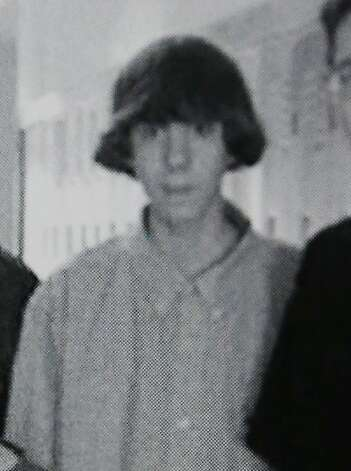 This undated photo shows Adam Lanza posing for a group photo of the technology club which appeared in the Newtown High School yearbook. Photo: Associated Press