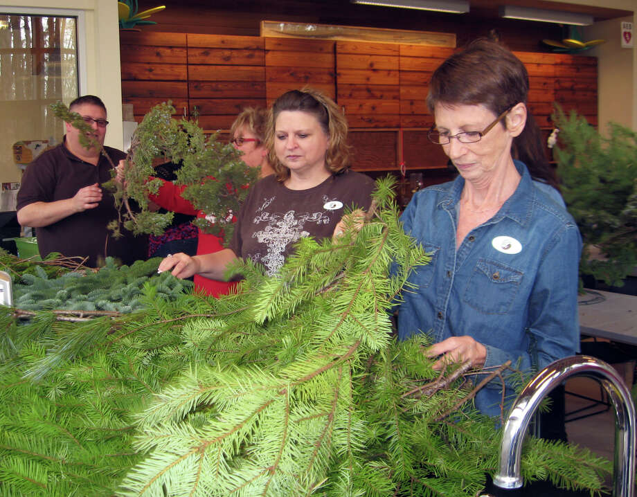 Participants at a wreath making workshop turn evergreen boughs into eye-catching Christmas decorations at Shangri La Botanical Garden's Green Christmas event Saturday. Photo: Sarah Moore