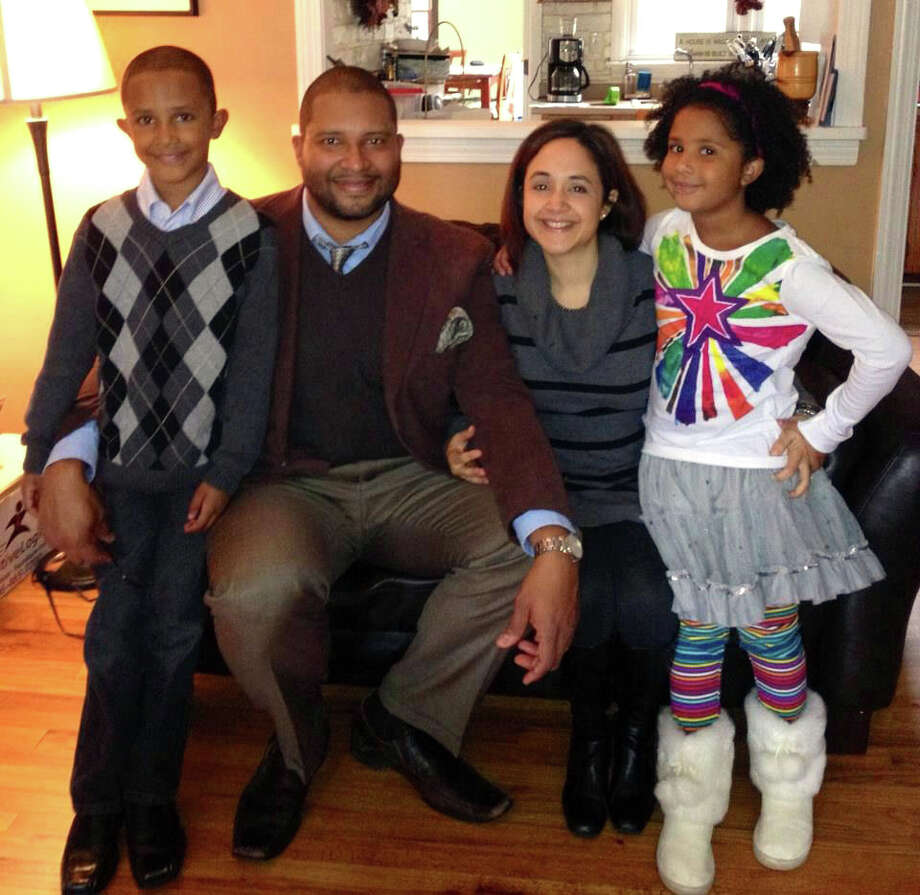 Tenor saxophonist Jimmy Greene with his family, son, Isaiah, wife, Nelba, and daughter, Ana Grace. Six-year-old  Ana Grace was one of the 20 children killed in the Sandy Hook Elementary School shooting in Newtown, Conn. on Friday, Dec. 14, 2012. Photo: Ottawacitizen.com Photo