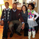 Tenor saxophonist Jimmy Greene with his family, son, Isaiah, wife, Nelba, and daughter, Ana Grace. Six-year-old  Ana Grace was one of the 20 children killed in the Sandy Hook Elementary School shooting in Newtown, Conn. on Friday, Dec. 14, 2012.