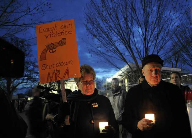 Gun control supporters take part in a candlelight vigil at Lafayette Square across from the White House on December 15, 2012 in Washington. Twenty-seven people, including the shooter, were killed on December 14 at Sandy Hook Elementary School in Newtown, Connecticut.    AFP PHOTO/Mandel NGANMANDEL NGAN/AFP/Getty Images Photo: MANDEL NGAN, AFP/Getty Images / AFP