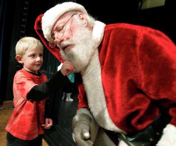 Santa lets 6-year-old Keton Sullivan tug on his beard after Keton asked him if he was the real Santa during the 45th annual LaPorte County Sheriff's Childrens Christmas Show, Saturday, Dec. 15, 2012 in LaPorte, Ind. Approximately 300 children attended the show which included a visit by Santa and Mrs. Claus who handed out presents and goodies to the children. Photo: Bob Wellinski, Associated Press / LaPorte Herald Argus/Bob Wellins