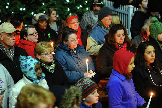 Hundreds attend a candlelight vigil in memory of victims from yesterday's mass shooting in Newtown, which was held behind Stratford High School on the Town Hall Green in Stratford, Conn. on Saturday December 15, 2012. Photo: Christian Abraham / Connecticut Post