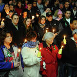 Hundreds attend a candlelight vigil in memory of victims from yesterday's mass shooting in Newtown, which was held behind Stratford High School on the Town Hall Green in Stratford, Conn. on Saturday December 15, 2012.