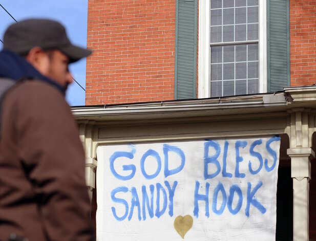 "A sign reads ""God Bless Sandy Hook,"" on a building in downtown Sandy Hook, Conn., Saturday, Dec. 15, 2012. Town resident Adam Lanza, 20, is suspected of killing 27 people at the school Friday morning. Photo: Bob Luckey / Greenwich Time"