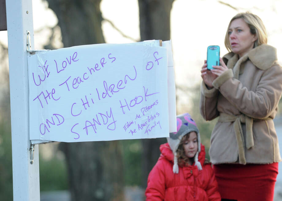 A sign of support for teachers near the Sandy Hook Elementary School in Sandy Hook, Conn., Saturday, Dec. 15, 2012. Town resident Adam Lanza, 20, is suspected of killing 27 people at the school Friday morning. Photo: Bob Luckey / Greenwich Time