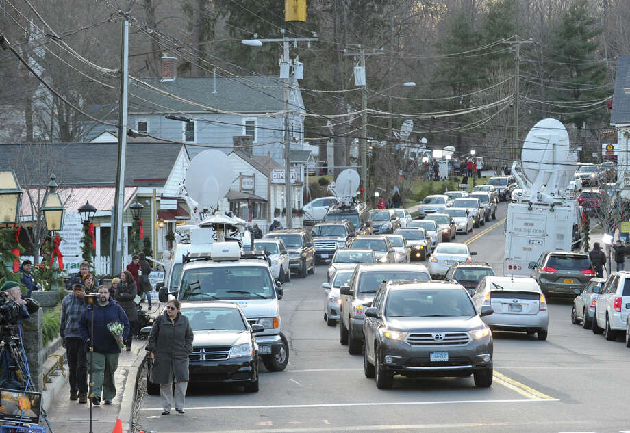 A congested Riverside Road in Sandy Hook, Conn., Saturday, Dec. 15, 2012. World-wide media has descended upon the small town after a shooting at Sandy Hook Elementary School in which 27 people were killed Friday morning. Town resident Adam Lanza, who was found dead at the scene, is suspected as the killer. Photo: Bob Luckey / Greenwich Time
