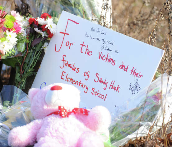 A shrine to the victims of the Sandy Hook Elementary School shootings on the corner of Riverside Road and Dickinson Drive in Sandy Hook, Conn., Saturday, Dec. 15, 2012. Town resident Adam Lanza, 20, is suspected of killing 27 people at the school Friday morning. Photo: Bob Luckey / Greenwich Time