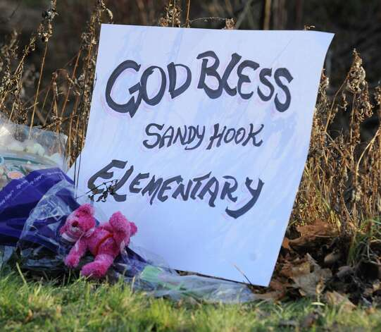 """God Bless Sandy Hook Elementary"" reads a sign near the Sandy Hook Elementary School sign which is on the corner of Riverside Road and Dickinson Drive in Sandy Hook, Conn., Saturday, Dec. 15, 2012. Photo: Bob Luckey / Greenwich Time"