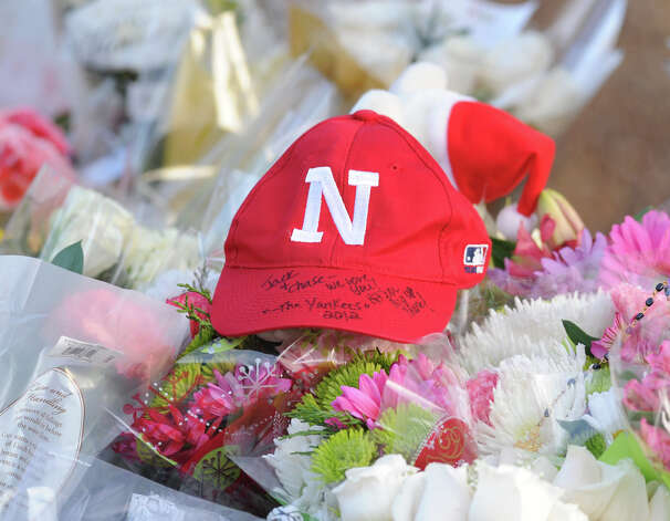 A Newtown hat rests on the shrine to the victims of the Sandy Hook Elementary School shootings on the corner of Riverside Road and Dickinson Drive in Sandy Hook, Conn., Saturday, Dec. 15, 2012. Town resident Adam Lanza, 20, is suspected of killing 27 people at the school Friday morning. Photo: Bob Luckey / Greenwich Time
