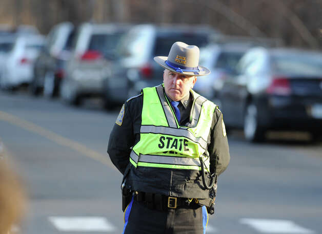 A State Trooper guards the entrance Sandy Hook Elementary School on the corner of Riverside Road and Dickinson Drive in Sandy Hook, Conn., Saturday, Dec. 15, 2012. Town resident Adam Lanza, 20, is suspected of killing 27 people at the school Friday morning. Photo: Bob Luckey / Greenwich Time